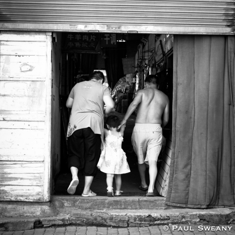 """A family entering a market."""